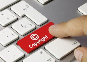 Copyright keyboard key. Finger